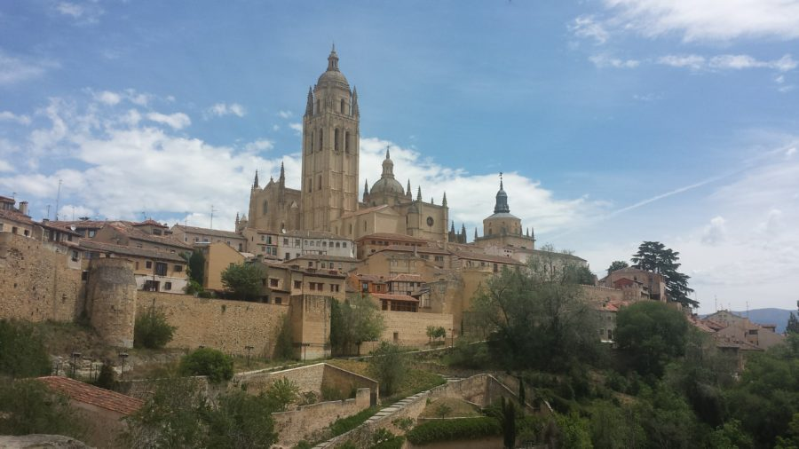 Views of Segovia, Spain, with lots of trails going down a hill.