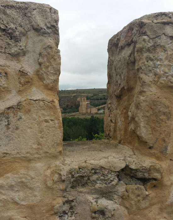 Views of a church from the top of the wall in Segovia, Spain