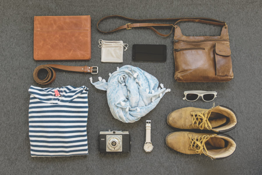 Layout of packing bag with clothes, shoes, bag, and more