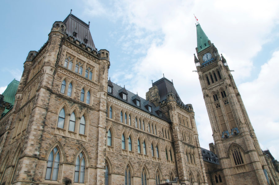 Low angle photo of the parliament buildings on Parliament Hill in Ottawa, Canada