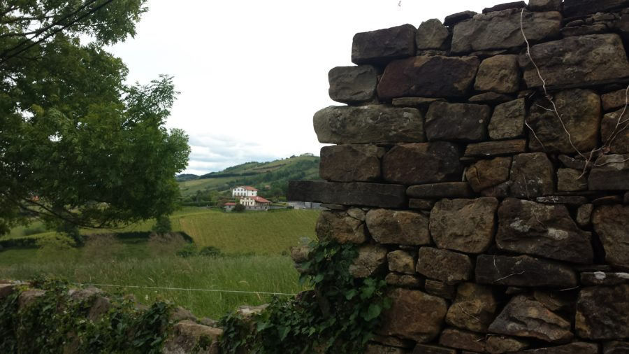 A stone wall and a farm, on the Camino de Santiago in Northern Spain