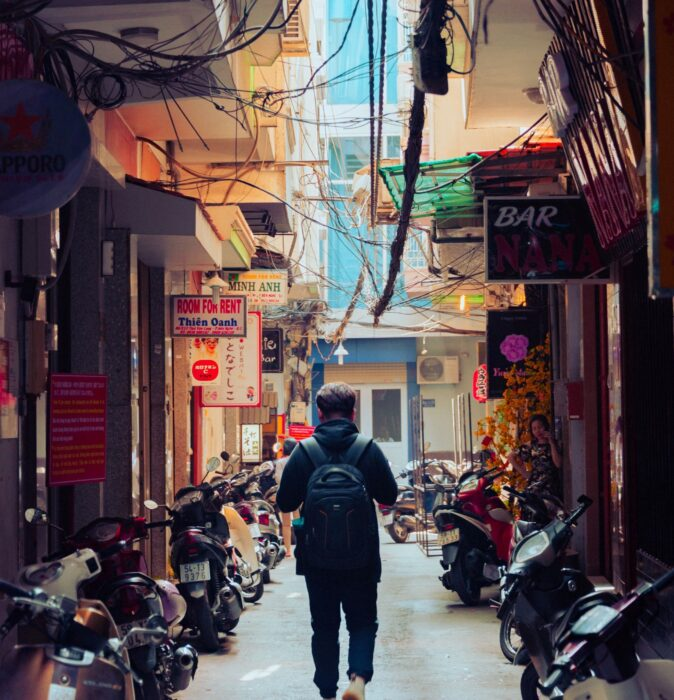 Backpacker Traveling on the Street in Asia