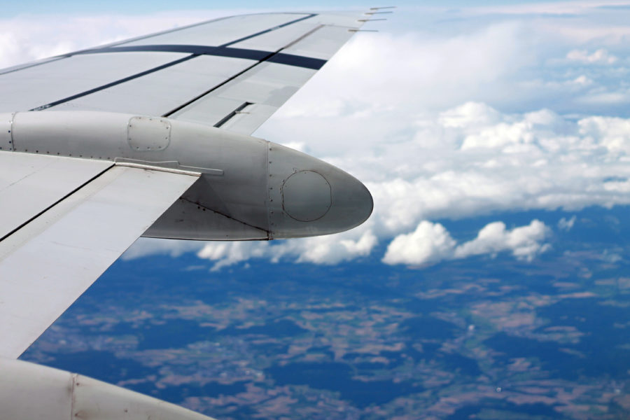 Airplane wing flying over the countryside