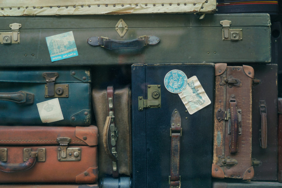 Many old, ratty suitcases stacked