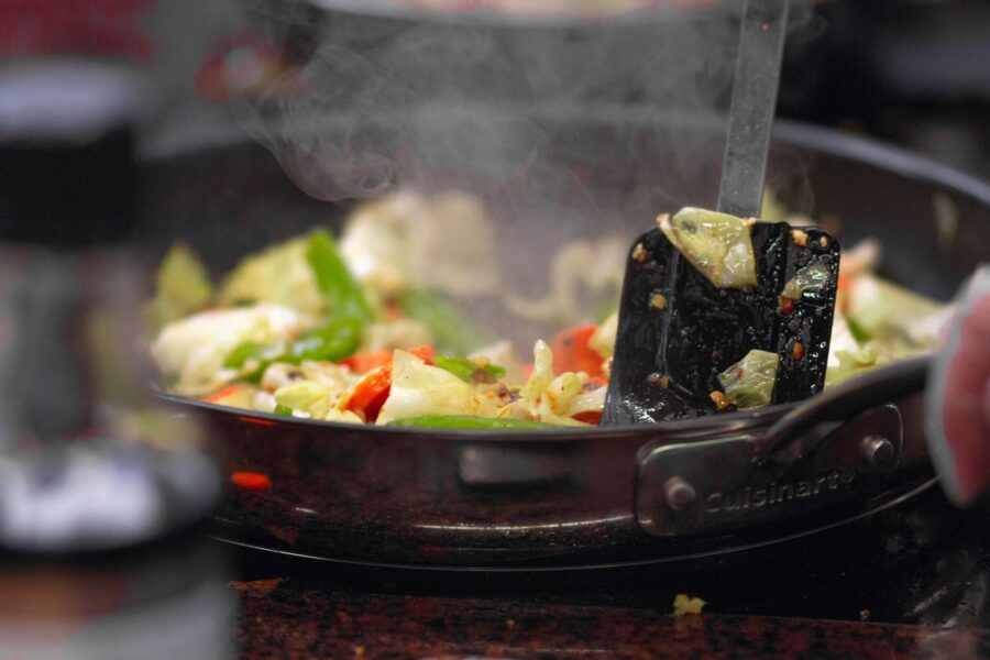 Cooking vegetables on a frying pan