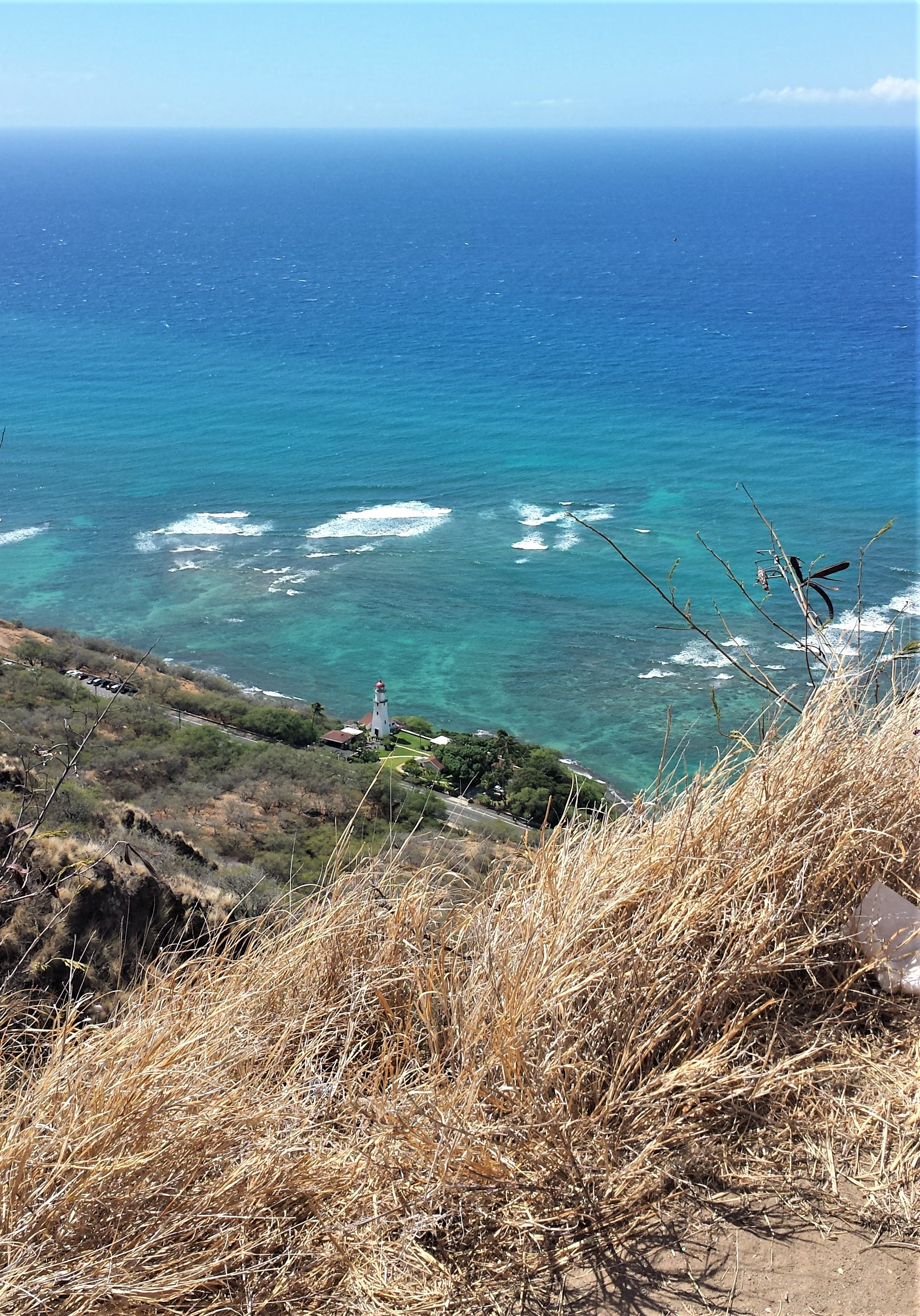 View of a lighthouse and the ocean from the Diamond Head Hike near Waikiki