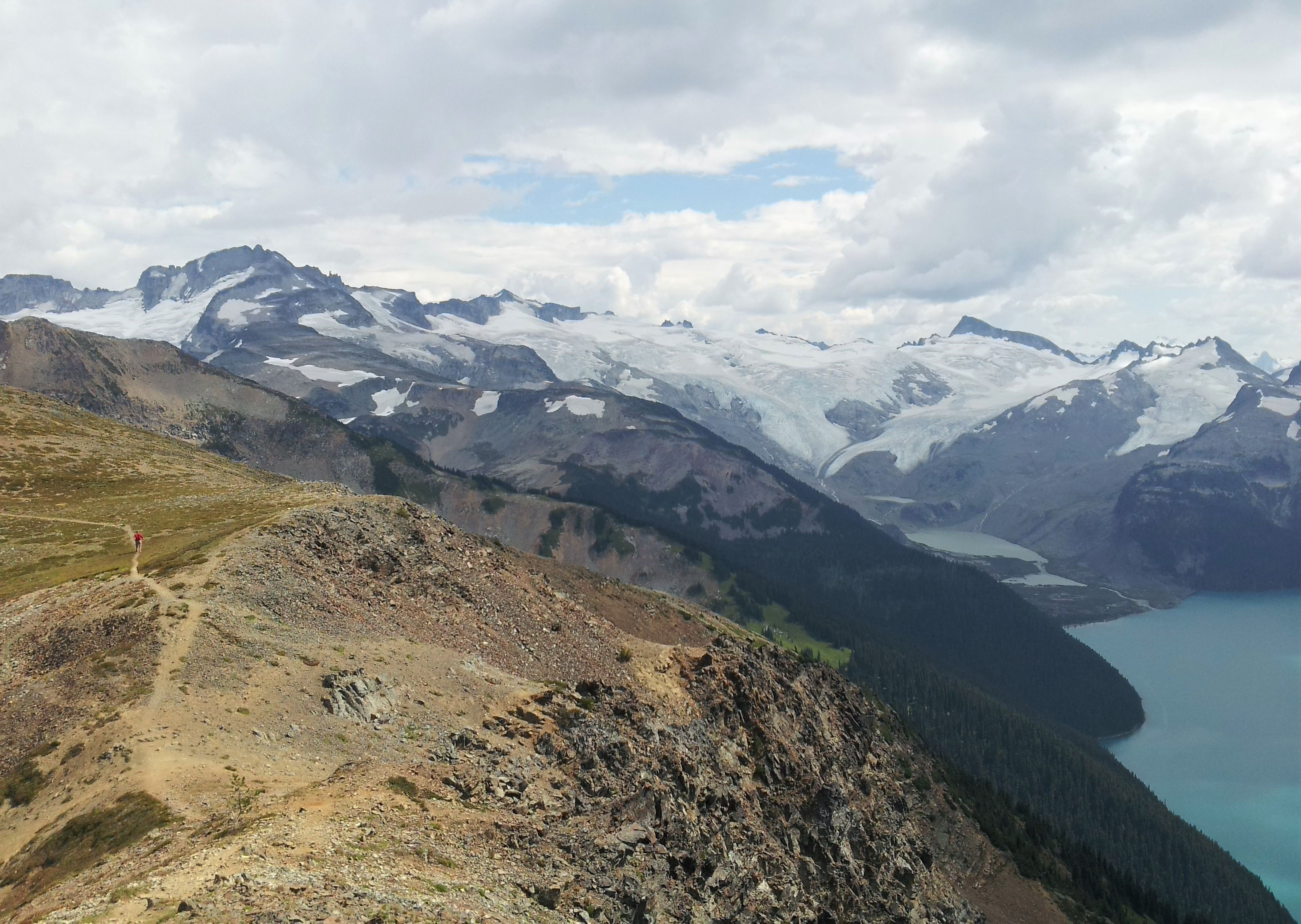 The view of the snow-capped mountains and lake from Panorama Ridge