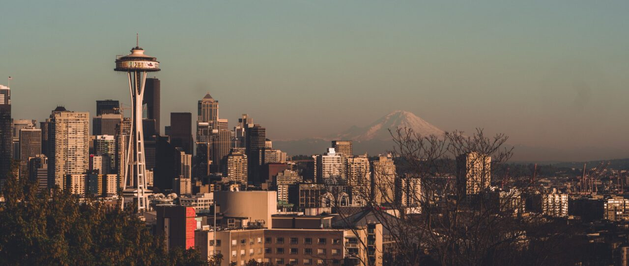 View of Seattle at sunset - Day Trips from Seattle Featured Image