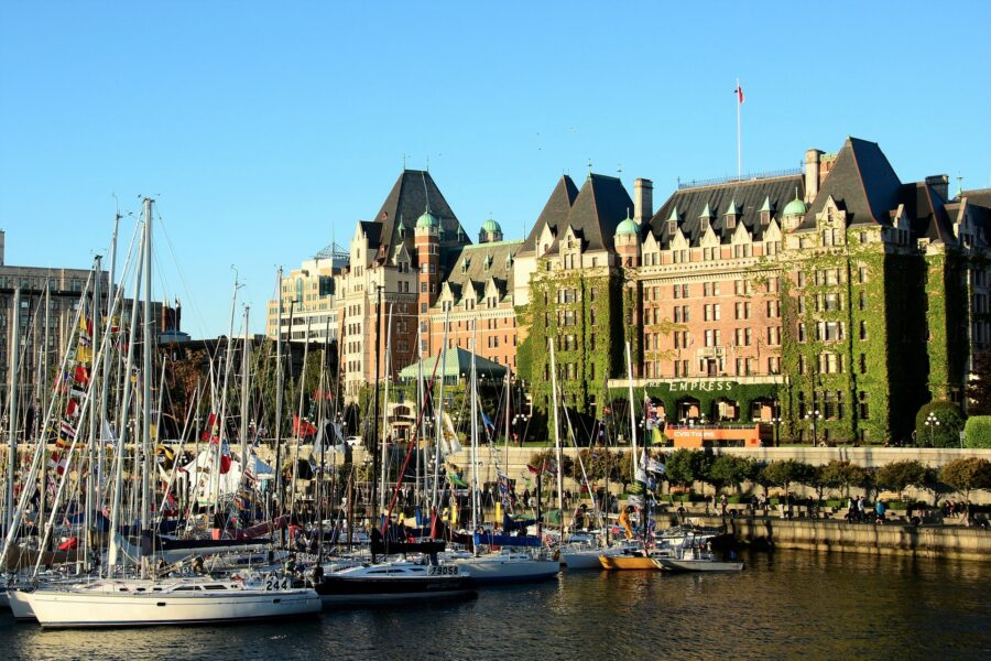 The Harbor surrounded by ships in Victoria, Canada - A ferry from Seattle, Washington