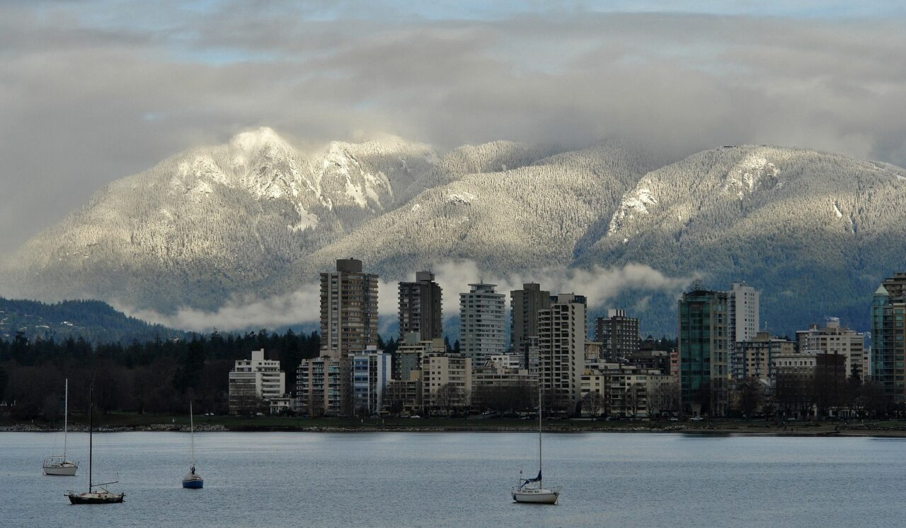 View of Vancouver and snowcapped mountains - Best Hikes in Vancouver Featured Image