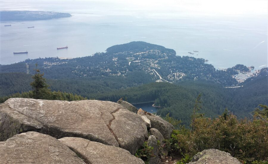 View of the Pacific Ocean and chipmunks on a rock at Eagle Bluffs, a hike near Vancouver