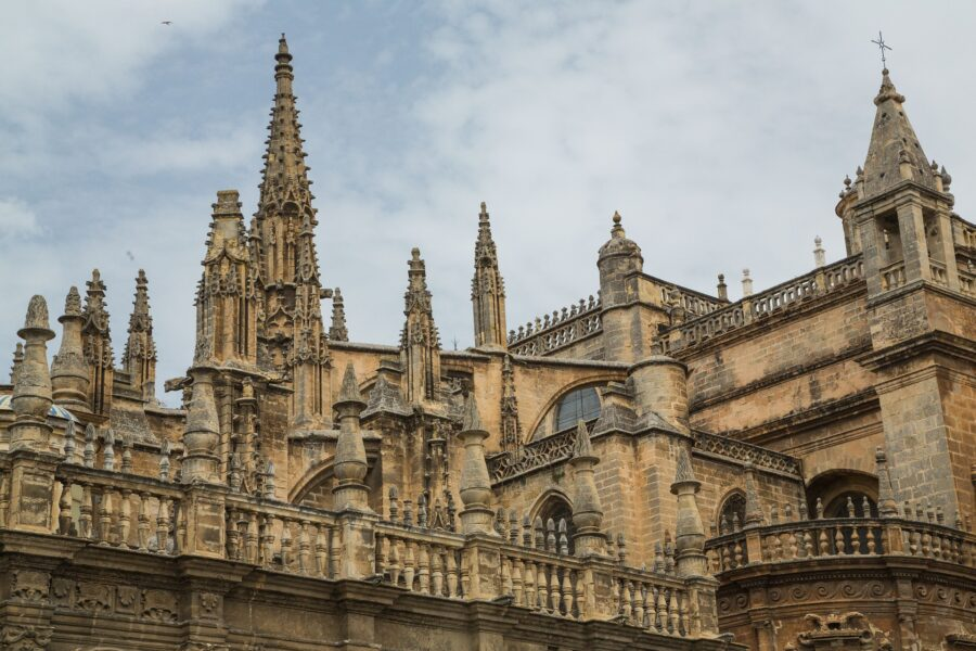 The Tan Exterior of the Seville Cathedral, one of the must-visit places on your Seville Walking Tour