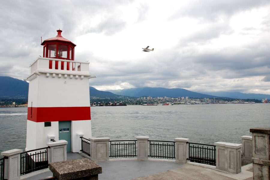 The Brockton Point Lighthouse, a red and white mini lighthouse on the Vancouver Seawall near Stanley Park, a stop on the Vancouver walking tour