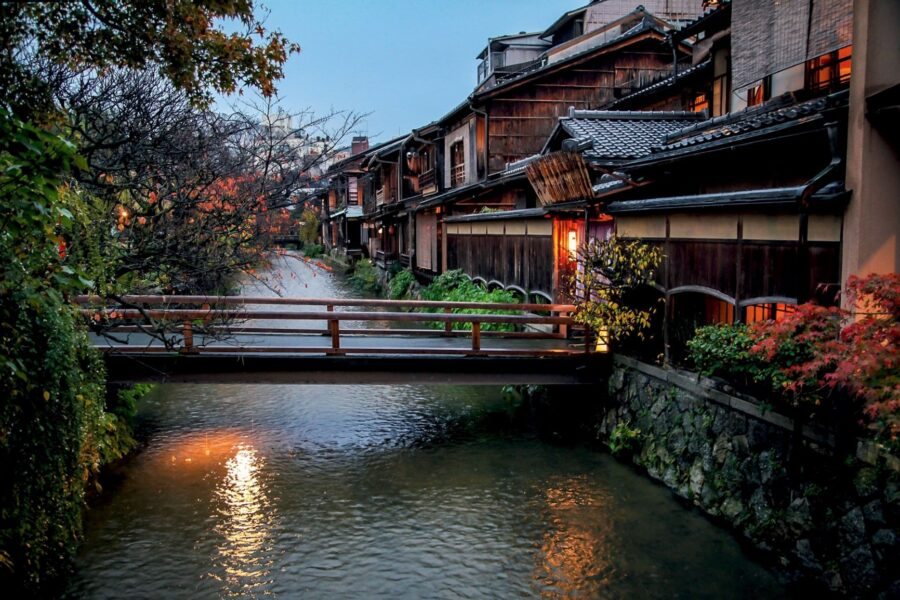 The canal area of the Gion district, one of the best Kyoto neighborhoods, with a bridge going to some Kyoto houses