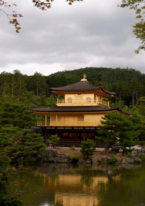The Golden Pavilion in Kyoto, surrounded by a pond and garden - one of the best temples in Japan