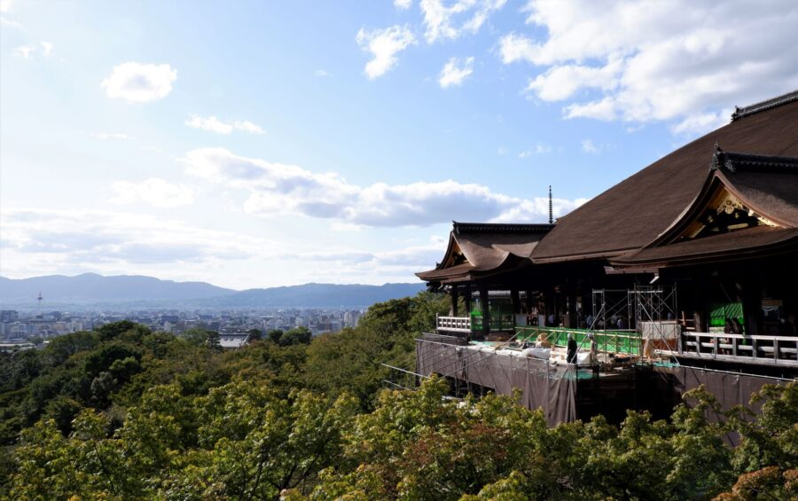 The large wooden terrace of Kiyomizu-dera Kyoto, under construction, with panoramic views of Kyoto