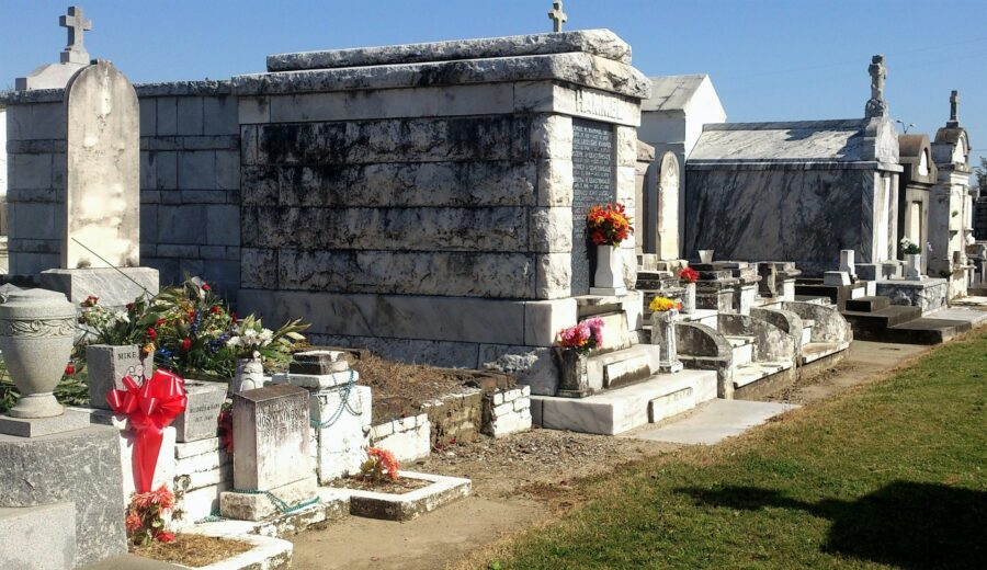 A few above-ground tombstones in a cemetery in New Orleans - what you have to see on your itinerary for New Orleans