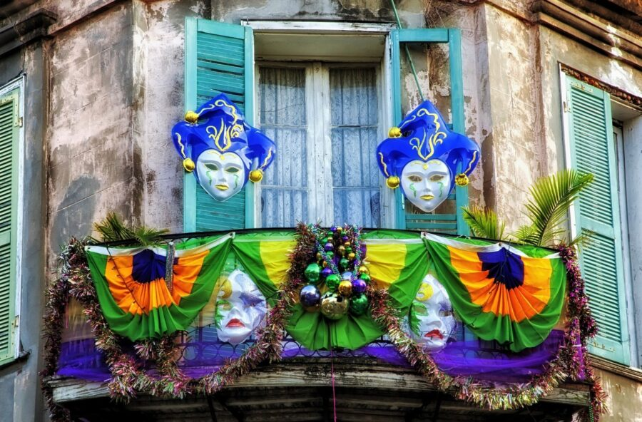 A balcony covered in masks and cloths during Mardi Gras Season in New Orleans - The Best Time to Travel to New Orleans
