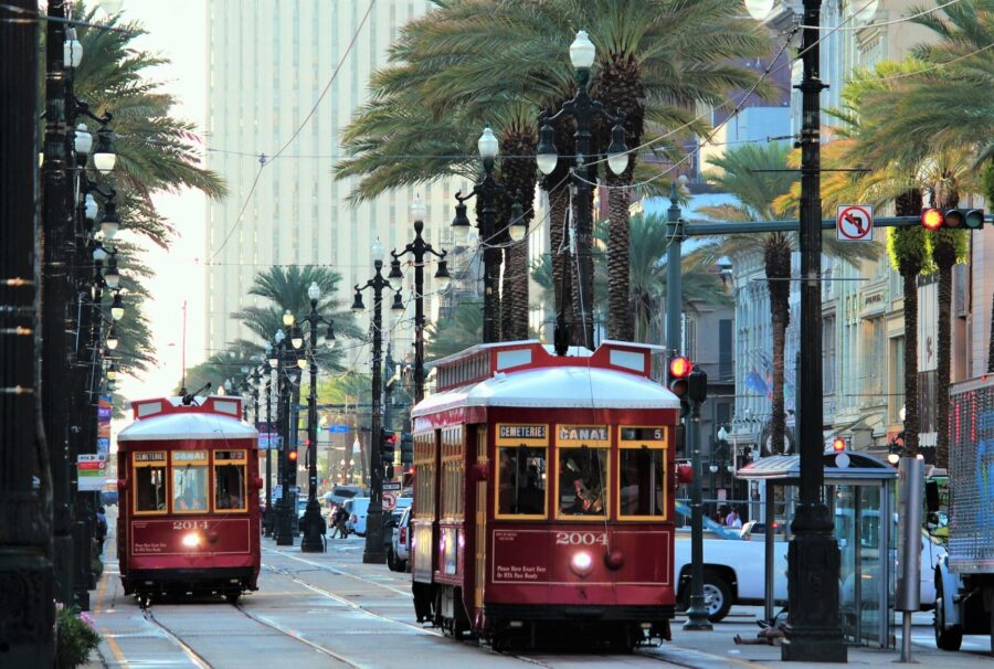 Two New Orleans streetcars (rail-guided tram cars) in the central city of New Orleans