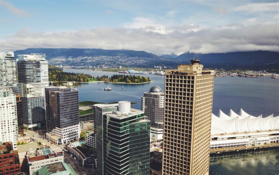 View of the Vancouver Skyline, Canada Place, the North Shore Mountains, and the Pacific Ocean from a building