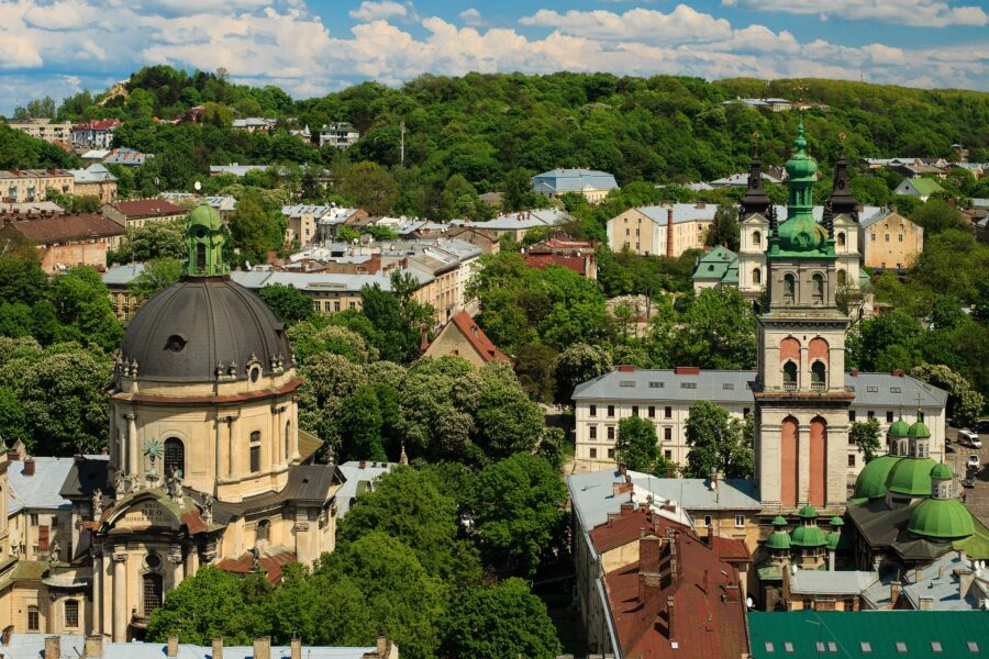 The colorful buildings and trees in a city in Ukraine, perfect as a cheap study abroad destination to travel as a student