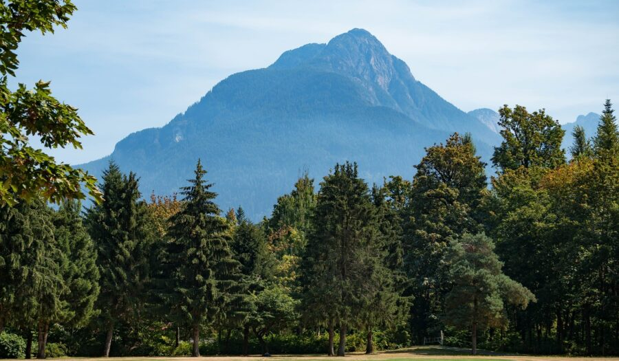 A towering mountain and forest in a park in Hope, BC - one of the stops on a Vancouver to Calgary drive