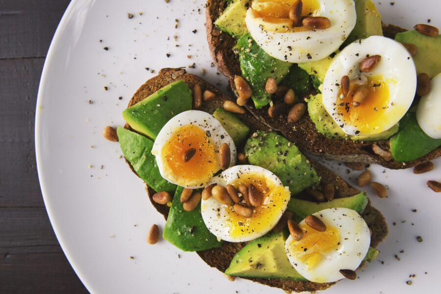 Avocado Toast with eggs and seeds, a hearty breakfast filled with healthy fats, perfect as hiking food