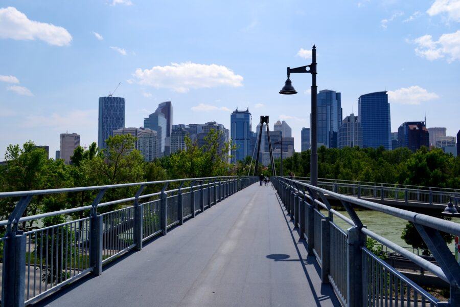 Bridge going over the Bow River near Prince's Island Park, with view of downtown Calgary - One of the free things to do in Calgary, Alberta