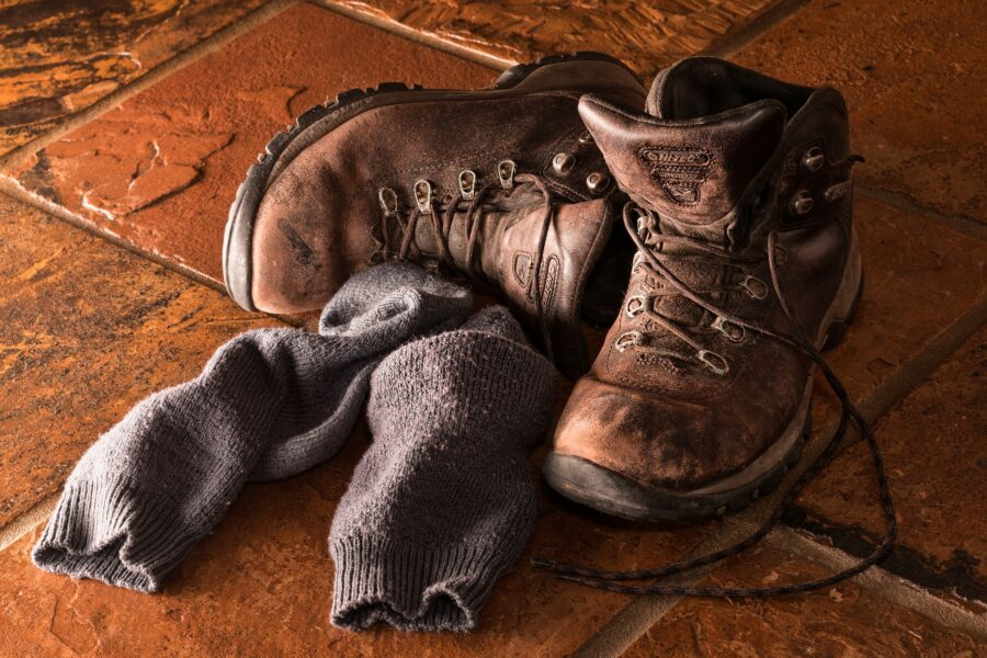 Some brown hiking shoes and wool socks, essential hiking gear you'll need - How to start hiking!