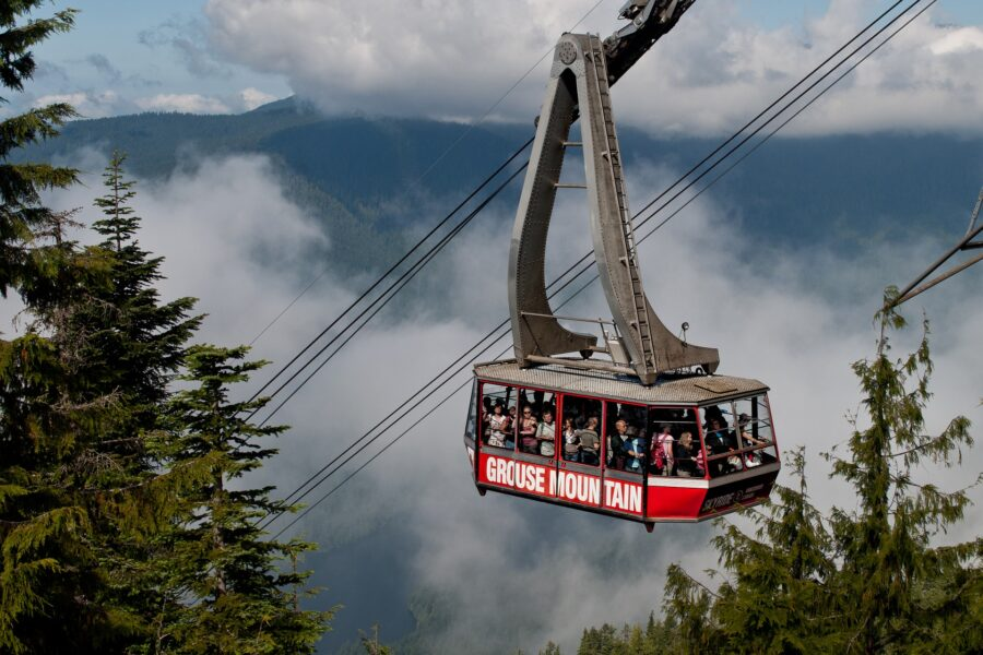 The red gondola filled with people going up Grouse Mountain, skipping the Grouse Grind, one of the best hikes surrounding Vancouver