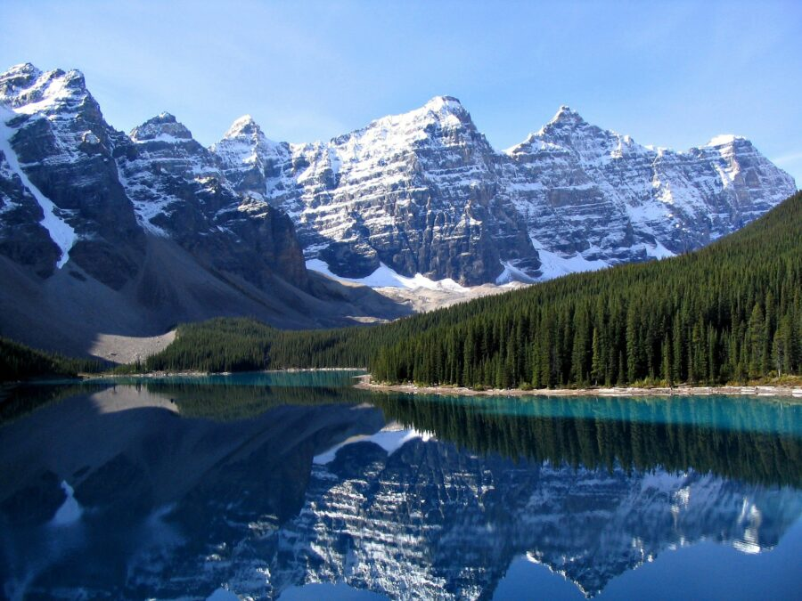 The rugged mountains, dense forests, and crystal, turquoise lakes near Banff - One of the essential stops on a Vancouver to Banff road trip