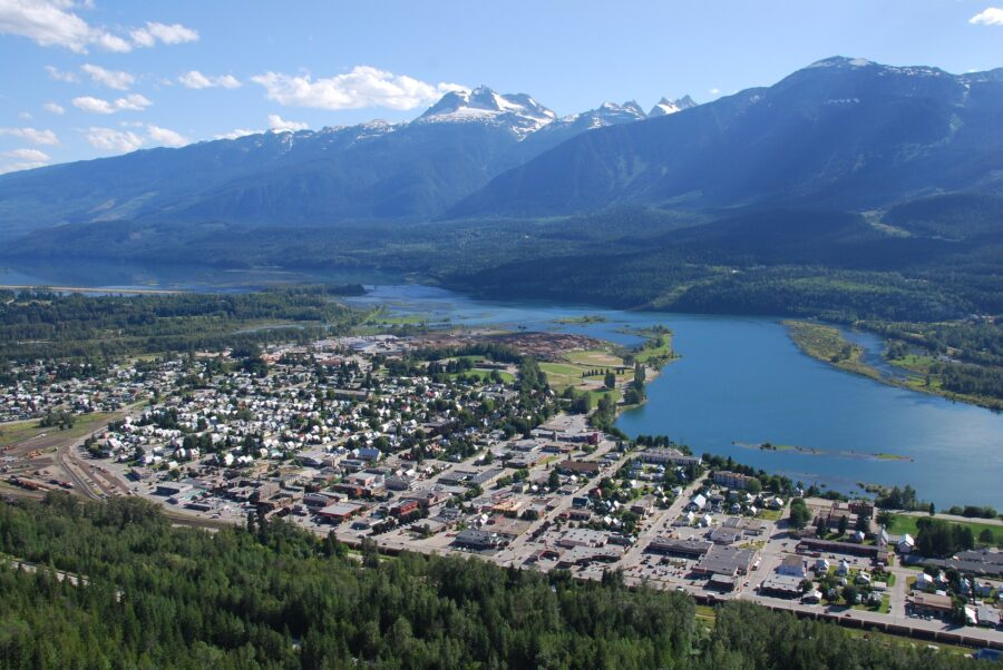 Viewpoint of the city of Revelstoke, BC, beside a river and surrounded by the British Columbia Rocky Mountains