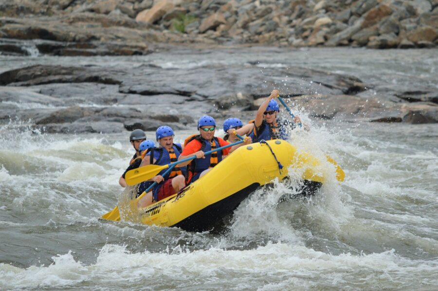 A group of around 7 people whitewater rafting near Golden, BC - a potential stop on your road trips from Vancouver!