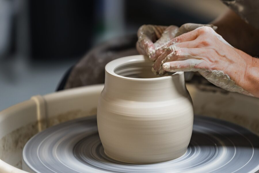 The two hands of an artist making a pot on the Ganges Art Studio Tour, one of the best things to do in Salt Spring Island in the summer