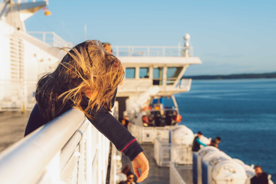 A young girl enjoying the views of the Pacific Ocean surrounding the Gulf Islands on a BC Ferry to Salt Spring Island