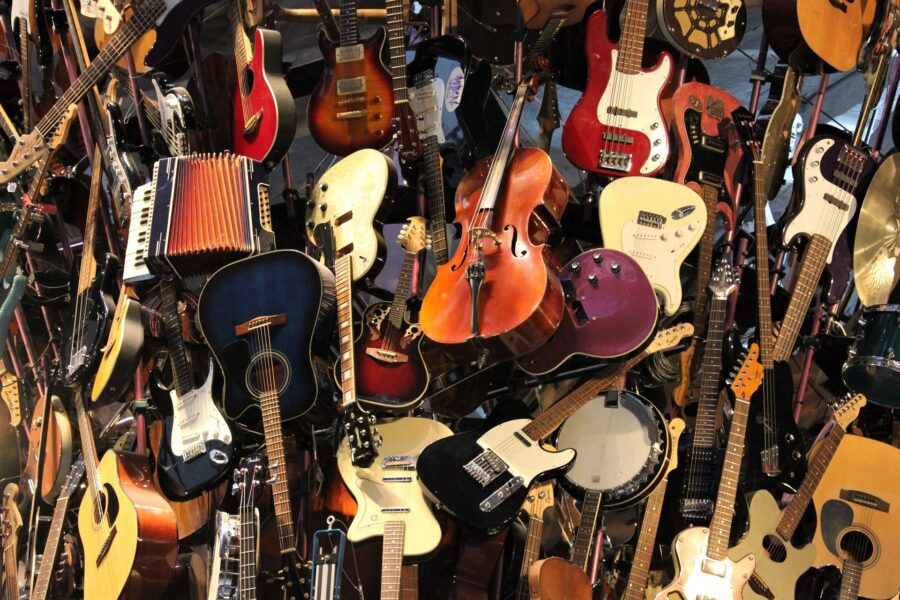 An art display of guitars and other string instruments hanging upside down at the Museum of Pop Culture in Seattle, Washington