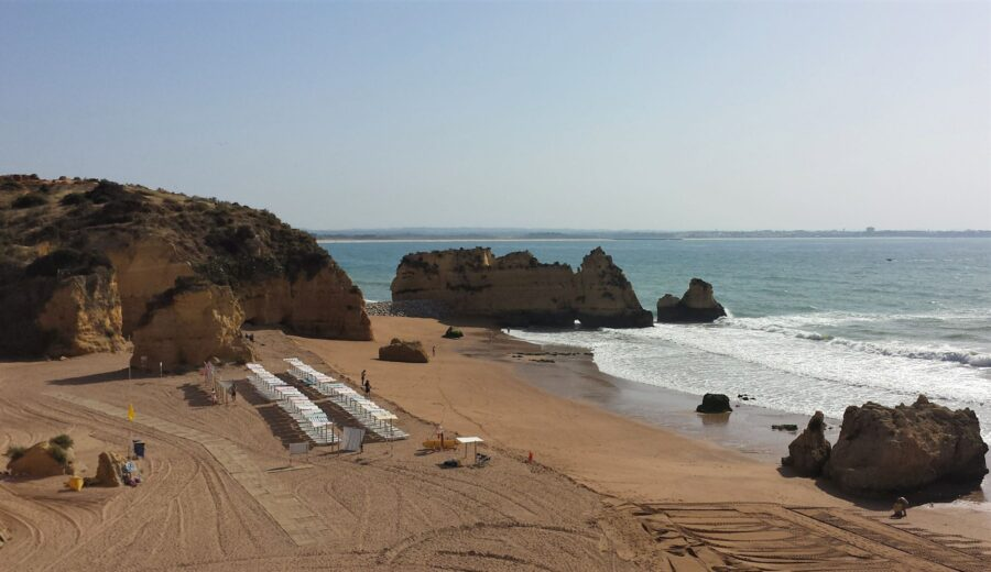 A nearly empty Praia Dona Ana early in the morning in Lagos Portugal