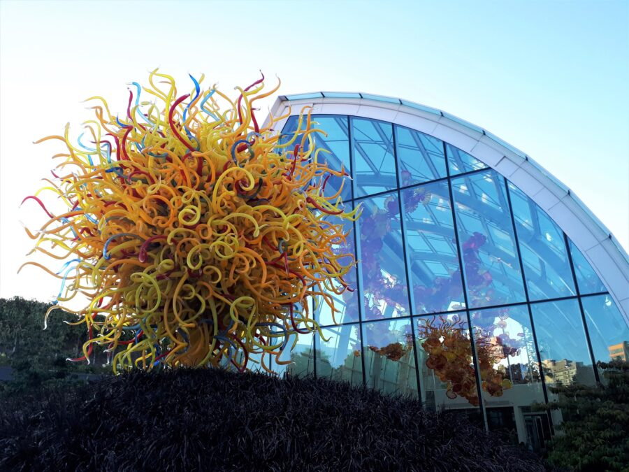 A mainly yellow glass art sculpture in the outside portion of the Chihuly Garden and Glass, my favorite spot on the Seattle free walking tour