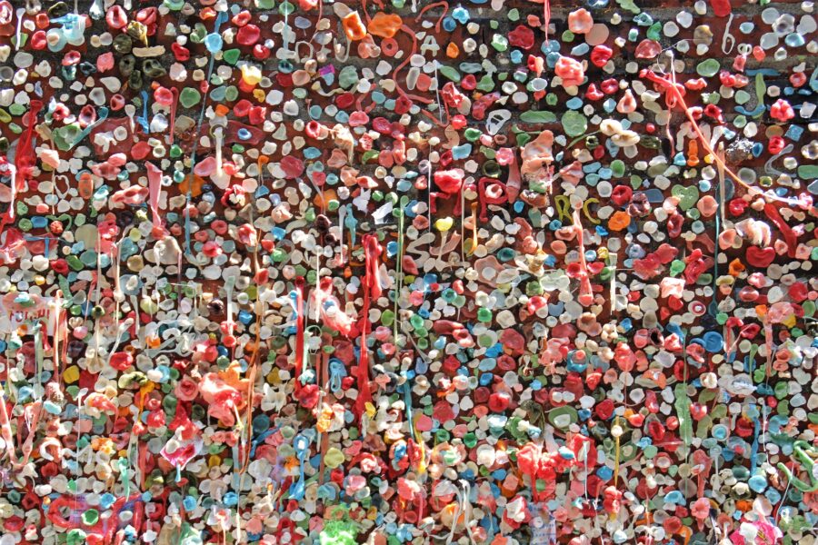 A section of the Gum Wall at Pike Place Farmer's Market in Seattle, with small bits of the brick wall visible under several colorful gum pieces