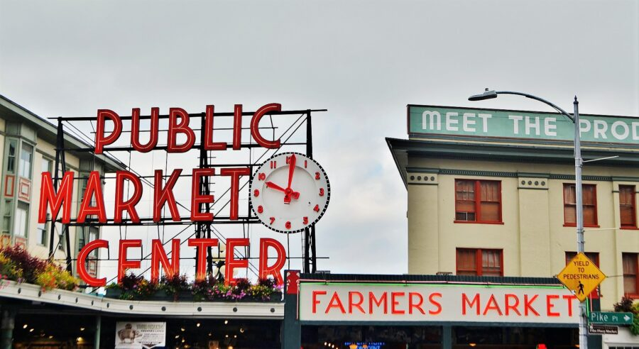 """The """"Public Market Center"""" sign at Pike Place Farmer's Market, the best stop on the walking tour of Seattle!"""