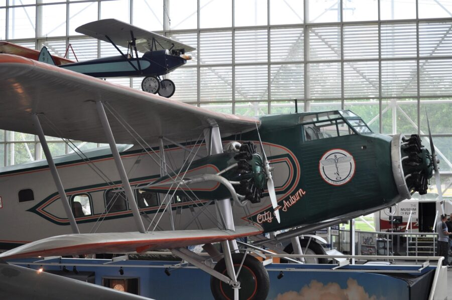 A display of a couple old airplanes, including a green propeller plane, at the Seattle Museum of Flight - one of the best indoor activities Seattle