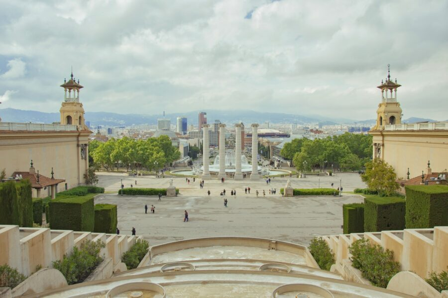 View of the city of Barcelona, the fountain, stairs, and four white pillars from the MNAC on Montjuic Hill Barcelona on a cloudy day