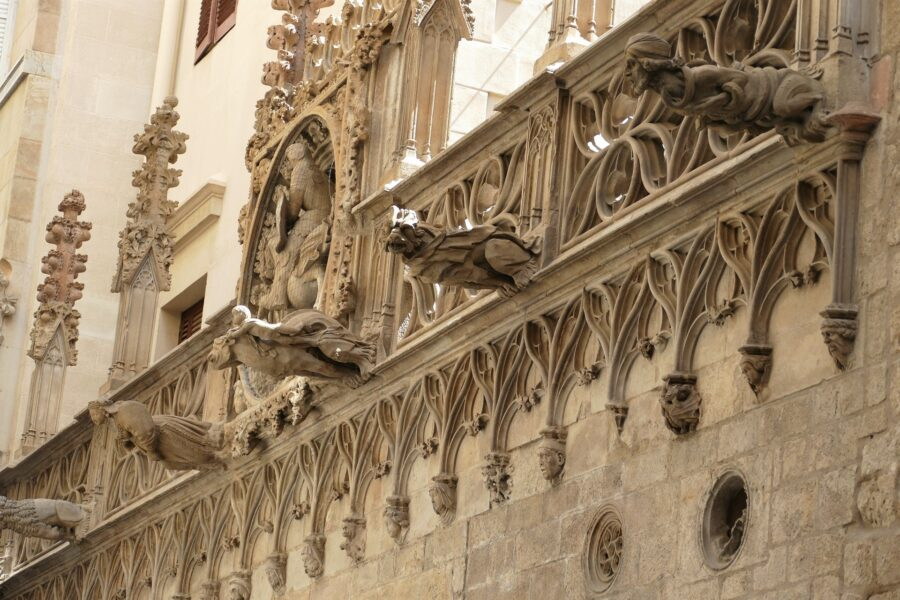 The Side of the Barcelona Cathedral, with small gargoyles sticking out of the tanned wall - an essential stop on your 2 day Barcelona itinerary