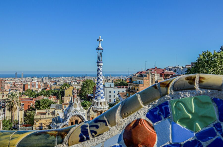 Views from Park Guell on a sunny day, including clear blue sky and colorful Gaudi architecture